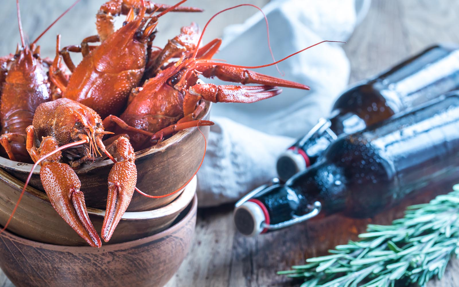 Bowl Of Boiled Crayfish With Bottles Of Beer